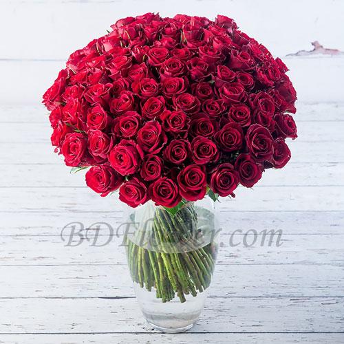 Send 100 pcs red roses in vase to Bangladesh